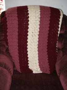 This free crochet afghan pattern is a mindless design which is where the name came from. It's a one row repeat throughout the entire pattern. Because the same stitch is used and there's no variation you can use multiple colors to add some fun.   http://www.allfreecrochet.com/Crochet-Afghan-Patterns/Stashaholics-Brain-Dead-Afghan/ml/1