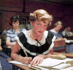 "Winnetka, Illinois. June 1950. ""Student Rue Lawrence wearing frilly summer dress and bright lipstick in classroom at New Trier High School."" Rue was on the cover of the October 16, 1950, issue of Life. Color transparency by Alfred Eisenstaedt, Life magazine photo archive"
