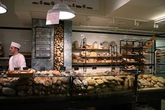 """At Eataly, we take breadmaking seriously. Our technique is an ancient art and the key is the highest quality ingredients: 100% organic stone ground flour from Don Lewis' Wild Hive Farm in New York and 150-year-old natural yeast from Italy called """"lievito madre"""". Choose from our vast selection of fresh bread made daily in our wood-burning oven and take home a piece of edible Italian art. It's the same bread we use to make our handcarved sandwiches at Rosticceria."""