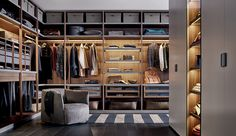 The customizable interior of this walk-in closet includes drawers in two heights, pull-out trays, handbag storage and hanging chests of drawers. Doors are available in leaf, sliding or folding versions,...