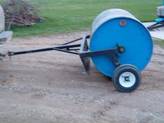 Lawn Roller by tigman250 -- Homemade lawn roller constructed from a surplus propane tank, steel tubing, bearings, and wheels. http://www.homemadetools.net/homemade-lawn-roller-2