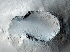"""Fountain """"Originally released May 30, 2007, this image is centered on a small cone on the side of one of Mars' giant shield volcanoes. The c... Image courtesy of NASA/JPL-Caltech/University of Arizona"""