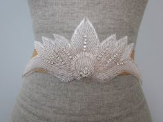 Hey, I found this really awesome Etsy listing at http://www.etsy.com/listing/156654694/art-deco-silver-beaded-fan-wedding-sash