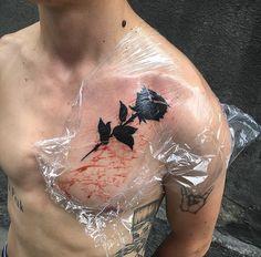 rose male tattoo