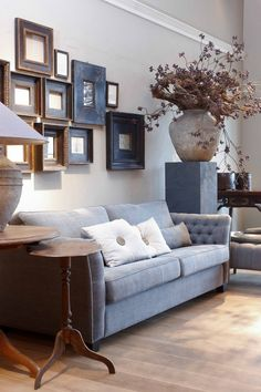 INTERIOR DESIGN INSPIRATION: Brown and blues looking gorgeous - reflecting the colour of the sofa in some of the frames is a subtle way to avoid one colour domination and introduce cohesion to the decor. Decor, Room, Home Living Room, Family Room, Home Decor, House Interior, Home Deco, Interior Design, Home And Living