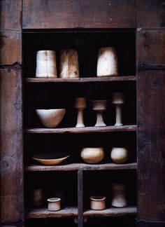 /\ /\ . Misczynski Home . The kitchen with a 17th C Italian walnut cupboard housing a collecion of Bactrian alabaster chalices, bowls, and dishes dating from the Second Millennium BC