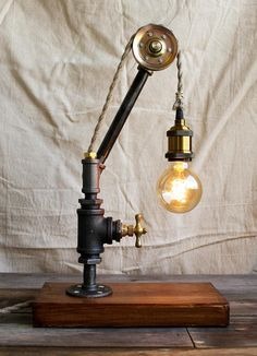 Industrial pipe lamp with bulb cage wood base table lamp x x base antique brass finish keyless light socket natural hemp twisted rope covered 18 gauge wire solid wood base with early american stain finish greentooth Images