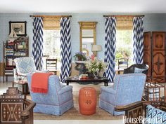 Living room in blues and a dash of orange. Design: John Knott and John Fondas.
