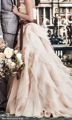 I will have a white dress but these colours are nice for the theme or brides maids. I like the flowers. I do not like the man's suit. -J