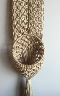 Lovely Retro Macramé Wall Planter! This is part of my Retro 70s/Mid Century Modern Design Collection and my Venus Line of Jute Plant Hangers. Theres something a little more earthy about jute. Its a bit more versatile than the rope because you can hang it outdoors as long as it is sheltered from direct sun, rain and snow. A great addition to Boho Hippie Decor! So authentic! It measures 51 long the ring is 7 across and that is the widest part of the piece. The pot and plant are not includ...