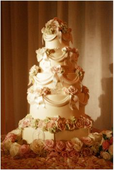 Beautiful wedding cake with buttercream flowers, draping, and monogram. Put the monogram on a higher tier and add a figurine to the top and I am completely sold.