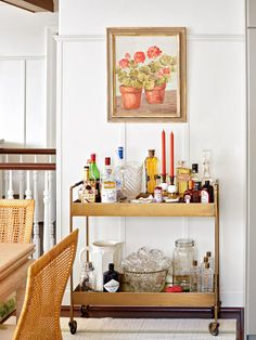 Bar carts serve as stylish yet hardworking hubs for entertaining. Learn how to style your beverage station with these beautiful bar cart ideas. #barcart #barcartstyling #barcartideas #barcartdecor #bhg Diy Bar Cart, Gold Bar Cart, Bar Cart Styling, Bar Cart Decor, Bar Carts, Cabinet Space, Bars For Home, Dining Area, Dining Room