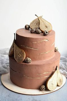 32 Jaw-Dropping Pretty Wedding Cake Ideas - Chocolate wedding cake adorned with gold pears and gold berries,Wedding cakes Pretty Wedding Cakes, Creative Wedding Cakes, Fall Wedding Cakes, Wedding Cake Designs, Pretty Cakes, Creative Cakes, Wedding Themes, Wedding Colors, Wedding Decor