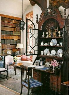 Library with a collector's cabinet on a secretary desk.