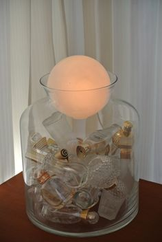 Good idea for my empty perfume bottles. Lamp - base has empty bottles of all the perfumes I ever owned :) Empty Perfume Bottles, Bottles And Jars, Glass Bottles, Perfume Display, Perfume Store, Channel Perfume, Perfumes Caravan, Bandeja Perfume, Halloween Perfume