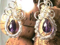 Brittany's to die for Amethyst drops wrapped up in Sterling Silver.  ~ Designed by the Feathered Mane