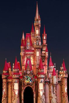 Cinderella's Castle transformed into the castle from Beauty and the Beast with lots of roses for Valentine's Day!
