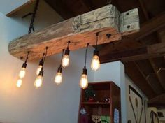 Recycle a wood beam into a rustic wood light fixture for your farmhouse lighting, home, bar, restaurant. old reclaimed barn wood give a rustic look! by Dixie Haysette Farmhouse Chandelier, Farmhouse Lighting, Rustic Lighting, Home Lighting, Lighting Ideas, Industrial Chandelier, Modern Lighting, Lighting Online, Industrial Lighting