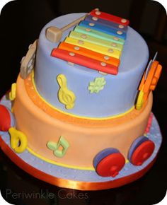 Would go with Little Einstein theme. Music themed birthday cake.