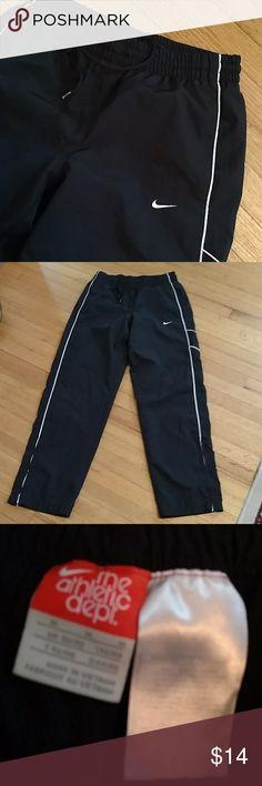 Mens nike athletic pants sz med Men's blue athletic pants w white trim. Back Velcro pocket. Sz med Nike Pants