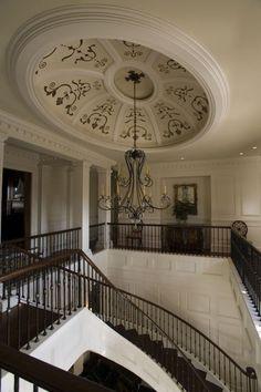 Ornate stairway in a Georgian style home. Herlong & Associates.
