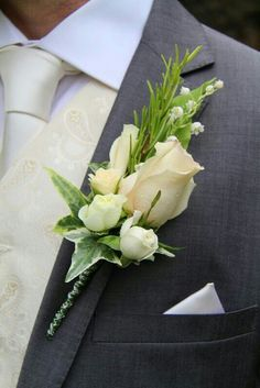 The Bride Groom's rather special boutonniere of fresh Lily of the Valley, Fragrant Rosemary, Rolled Rose Petals, Gracia Creme and 4 Good tiny buds and a beautiful Quicksand Rose Prom Corsage And Boutonniere, Corsage Wedding, Groom Boutonniere, Boutonnieres, Prom Flowers, Bridal Flowers, Bride Bouquets, Floral Bouquets, Floral Wedding