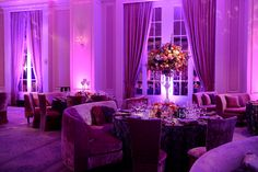 Kordell & Porsha Stewart's gorgeous reception featuring purple velvet seaing and mirror tabletops at the St. Regis in Atlanta. Wedding by Tiffany Cook Events