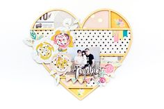 The wood veneer heart framework product from Confetti is definitely one of my favorite new items that we added to the collection. It's one of those products that can be used in so many different ways and you can get a whole bunch of different looks, depending on which papers and other things you use…