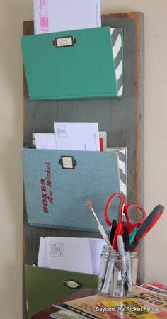 Old books turned into a wall mail rack.