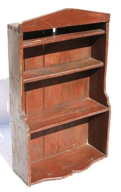"19thC pine hanging shelf in old red paint - 33"" ta"