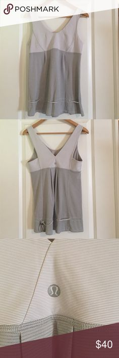 Lululemon tank top Like new!  Tank was worn twice. I love it, but it just doesn't fit my post baby body like it did when I bought it. 😞. Adorable drawstring around the waist and pleats in back. lululemon athletica Tops Tank Tops