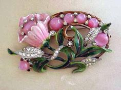 Enameled floral brooch with pink cabochons