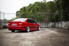 Red BMW e36 sedan on cult classic BBS RS wheels