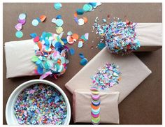 After wrapping your present, cover one end in double-stick tape and dip it in confetti. Glitter would work too, although your friend or loved one might not forgive you if it means they'll be covered in it for the rest of their earthly days.