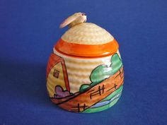 Clarice Cliff Fantasque Bizarre 'Orange Roof Cottage' Small Beehive Honey Pot c1932