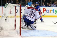 NEW YORK, NY - MAY 25:  Martin St. Louis #26 of the New York Rangers scores the game winning shot in overtime against Dustin Tokarski #35 of the Montreal Canadiens to win Game Four of the Eastern Conference Final in the 2014 NHL Stanley Cup Playoffs at Mad