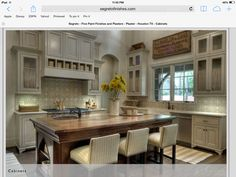 Cabinets painted a warm grey or greige compliments the wood island