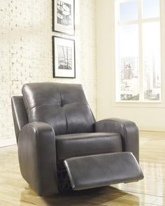Description Dimensions More Info Ashley Furniture Mannix DuraBlend Swivel Glider ReclinerDuraBlend/Match upholstery features DuraBlend upholstery in the seating areas with skillfully matched Polyurethane everywhere else. With the sleek contemporary design...