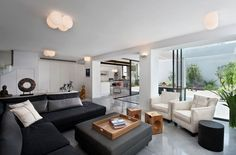 Villa: Cozy Modern Design Living Room Featuring Black Fabric Sectional Sofas Also White Armchairs Plus Wooden Foot Stools And Grey Square Coffee Table Also Awesome Ceiling Lamp Shades Ideas: Exquisite Modern Villas Design