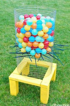 "What a fun idea! Your very own ""kerplunk"" board game brought to life.  Let little ones pull out the sticks while trying NOT to make the balls fall.  Make it into a math game by counting how many balls fall each turn."