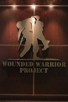 Secrets In Lace Co-founder, President and Chief Designer Daniel Whitsett Presents $10,000 to the Wounded Warrior Project.