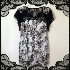 Black & White Tunic Top/Short Dress w Lace & Bows Bought from eb@y several years ago and never ended up wearing it. Could be worn as a very short dress but might be better as a long top. ;) Asian one size fits all so fits US XS-M best. *This price is firm. *No trades. No PayPal. I only sell on Poshmark. If you have any questions, feel free to ask.* Tops Tunics