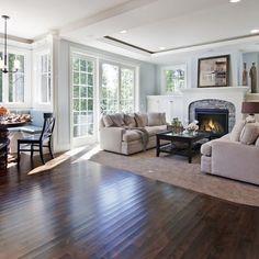 love the fireplace, built-ins, and windows above