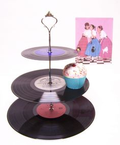 Retro Vintage 50's Record Dessert 3 Tier Pedestal Cake Cupcake Stand Recycle Great for Wedding Birthday Graduation Party Lets Rock. $19.99, via Etsy.