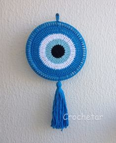 Greek eye is a talisman against envy and evil eye, it is also . Diy Crochet Stitches, Crochet Eyes, Crochet Mandala Pattern, Crochet Home, Love Crochet, Crochet Gifts, Crochet Designs, Crochet Flowers, Crochet Baby