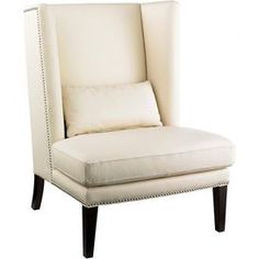 "Wingback chair with linen-inspired upholstery and nailhead trim.  Product: Chair Construction Material: Solid wood and fabric Color: Espresso and cream Features:   Nailhead trim 19"" Seat heightPillow included           Dimensions: 42"" H x 31"" W x 32"" D"
