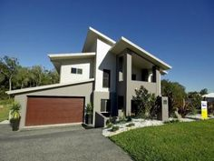 Weatherboard modern house exterior with balcony & rockery - House Facade photo 506241