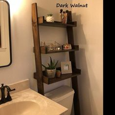 This listing is for an over-the-toilet ladder shelf. Its a great space saver. It does ship disassembled so please read the rest of the description. We do have some Dark Walnut stained ladder shelves that ship within 1 business day that you can view here: Bathroom Ladder Shelf, Toilet Shelves, Bathroom Storage Shelves, Toilet Storage, Boho Bathroom, Wall Shelves, Small Bathroom, Shelving, Bathroom Stuff