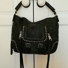 SAM EDELMAN BLACK DISTRESSED BIKER BAG Sam Edelman black distressed biker bag! Is in excellent condition.  Doesn't even look like it's been used before. I know I haven't used it.  No wear outside or inside at all. Has stunning studs for added bling of bag and beautiful braidinh detail on thr shoulder strap. Great for everyday use!! Sam Edelman Bags Shoulder Bags