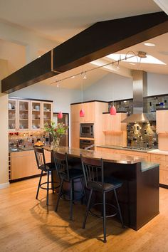 contemporary kitchen by Robin Rigby Fisher CMKBD/CAPS  Wood beams can be modern